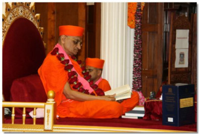 Acharya Swamishree peruses pages of the Bible