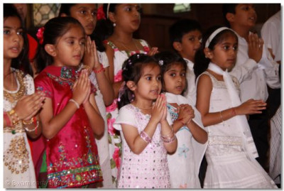 Young disciples perform a devotional song to please Lord Shree Swaminarayanbapa Swamibapa