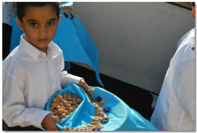 The children carried platters with cashews ivory in colour and saffron almonds
