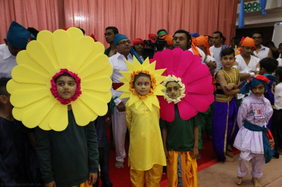Young disciples dressed in a variety of dancing costumes excited to be taking part in the evening devotional dance performances
