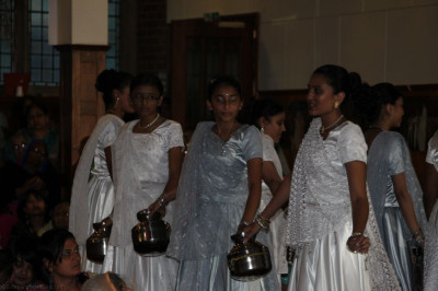 Disciples perform devotional dances with a large metallic Indian pot reliving the dances from 13 years ago during the Murti Pratishta Mahotsav in London in 2000