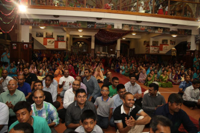 Hundreds of disciples enjoy the evening's historical devotional dance performances at Shree Swaminarayan Temple London