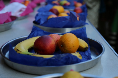 A variety of fresh fruit is arranged for young disciples to present to Lord Shree Swaminarayanbapa Swamibapa and His Divine Holiness Acharya Swamishree