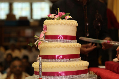 A close up of the three tiered Birthday cake