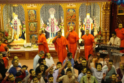 Sants and disciples sing traditional devotional songs as disciples and sants take part in raas