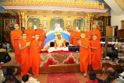 His Divine Holiness Acharya Swamishree blesses all Sants after applying sandalwood paste