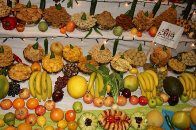 A close up of the intricately carved fruits and vegetables and savoury items that form part of the Annakut