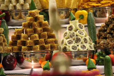 A close up of some of the sweet dishes arranged in the Annakut