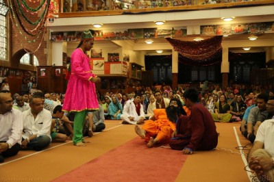 Young disciples perform a devotional drama depicting the meaning and greatness of Gurupoonam