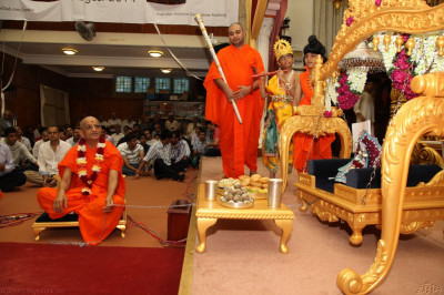 His Divine Holiness Acharya Swamishree lovingly swings Shree Harikrishna Maharaj