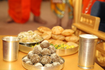 Traditional Indian sweets and savouries are offered to Shree Harikrishna Maharaj
