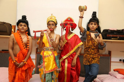 Young disciples dressed up as devtas prepare to join the Janmashtami - Anniversary of the manifestation of Sadguru Shree Ramanand Swami celebrations