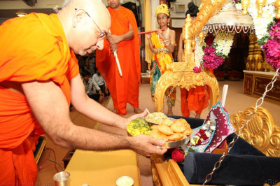 Sants offer traditional Indian sweets and savouries to Shree Harikrishna Maharaj