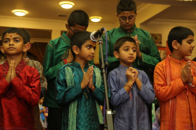 "Young disciples perform the traditional devotional song  ""Ne Samaju Shreeji Shi Rithe "" to please Lord Shree Swaminarayanbapa Swamibapa and His Divine Holiness Acharya Swamishree"