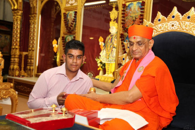 His Divine Holiness Acharya Swamishree presents disciples with an Achievement award for attaining high academic results this year in various disciplines ranging from GCSE, A-level, BTECs,  through to Bachelor degrees