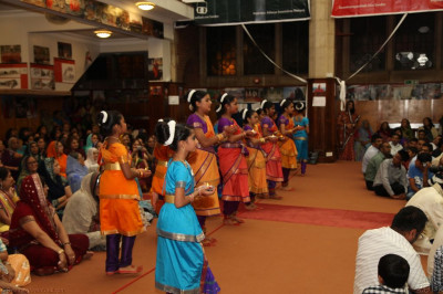 Young disciples perform a Bharatanatyam dance to please Lord Shree Swaminarayanbapa Swamibapa