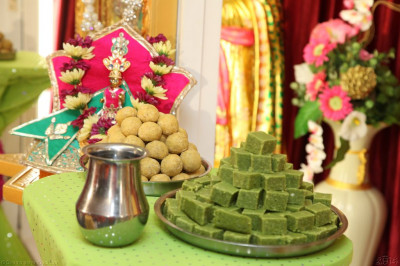 Traditional Indian sweets are offered to Shree Harikrishna Maharaj