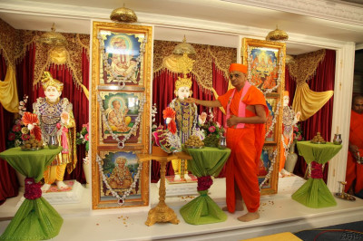 His Divine Holiness Acharya Swamishree offers traditional Indian sweets to Lord Shree Swaminarayan