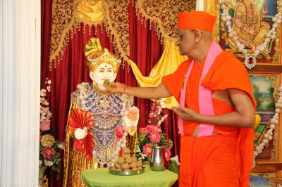 His Divine Holiness Acharya Swamishree offers traditional Indian sweets to Jeevanpran Shree Abji Bapashree