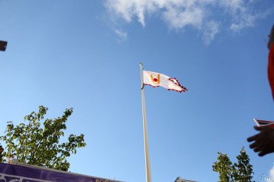 A view of the new flag against bright blue skies at Shree Abji Bapashree House Kingsbury