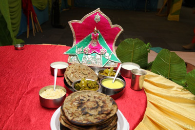 Shree Harikrishna Maharaj dines on a traditional evening meal