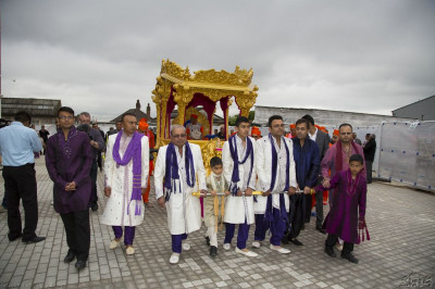 Disciples who have sponsored the celebrations pull the golden chariot through Shree Muktajeevan Swamibapa Complex