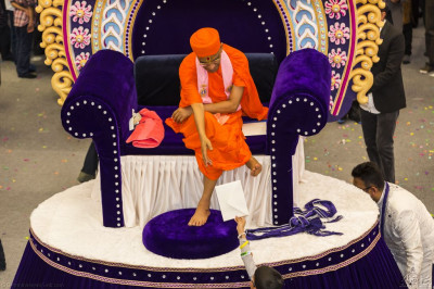 His Divine Holiness Acharya Swamishree graciously accepting various gifts offered by disicples