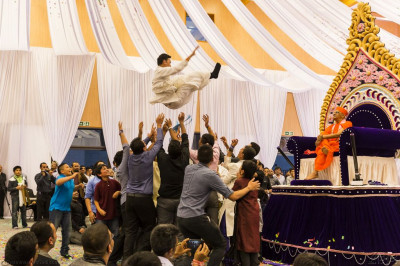 Disciples rejoice and choose to launch the Maharaj of Shree Swaminarayan Mandir Kingsbury into the air to please the Lord
