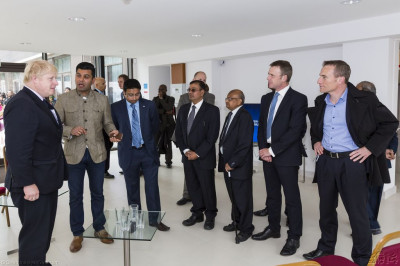 Disciples explain the monumental significance of the grand opening of Purushottam Mahal to the Mayor Of London and his officials