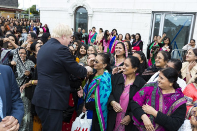 All are delighted as the Mayor of London Boris Johnson shakes hands and poses for photos