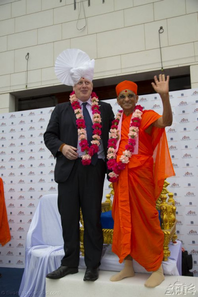 His Divine Holiness Acharya Swamishree blessing all with the Mayor of London Boris Johnson