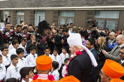 The Mayor of London Boris Johnson proceeds to greet each of the academies and their members
