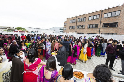 All disciples and guests dine on prasad dinner as the event concludes early into the evening