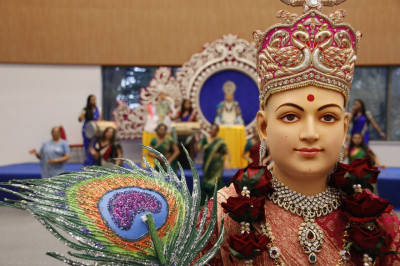 Divine darshan of Lord Shree Swaminarayan holding a peacock feather