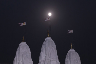The Sharad Poonam full moon shines its soothing cooling light above the three magnificent shikars of Shree Swaminarayan Mandir Kingsbury