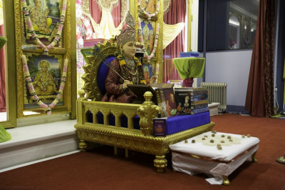 Divine darshan of Lord Shree Swaminarayan seated upon Shree Swaminarayan Gadi writing the Shikshapatri scripture on the 188th anniversary of the completion of the Shikshapatri