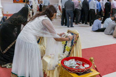 Disciples offer garlands of fresh flowers to  Lord Shree Swaminarayan as part of the poojan ceremony