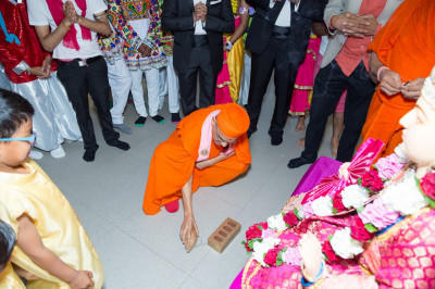 His Divine Holiness Acharya Swamishree performs the auspicious coconut breaking ceremony