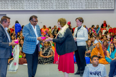 Disciples present prasad shawls and momentos to the Mayor of Brent