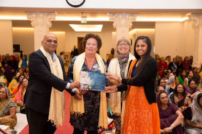 Honoured guests presents an Excellence award to the disciple for very high educational attainment