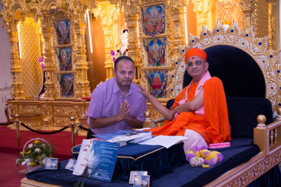 His Divine Holiness Acharya Swamishree blesses the disciple who sponsored the event
