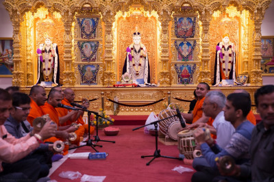 Sants and disciples celebrate ekadasi by singing traditional devotional songs accompanied by instruments