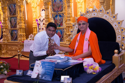 His Divine Holiness Acharya Swamishree presents sporting achievement awards to disciples