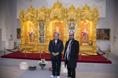 Shri Bhupendrasinh Jii Chudasama in front of the golden sinhasan at Shree Swaminarayan Mandir Kingsbury