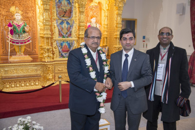 Shri Bhupendrasinh Jii Chudasama is presented with a garland of fresh flowers by one of the trustees of Shree Swaminarayan Mandir Kingsbury