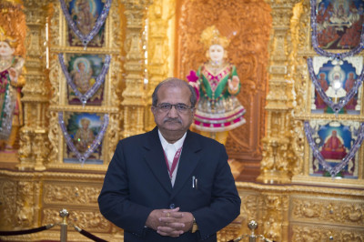 Shri Bhupendrasinh Jii Chudasama in front of Lord Shree Swaminarayan at Shree Swaminarayan Mandir Kingsbury