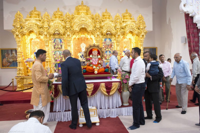 Disciples perform poojan