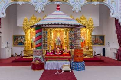 Divine darshan of the hindola made from sweets and chocolates
