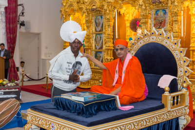 His Divine Holiness Acharya Swamishree blesses a member of the Kenyan International cricket team