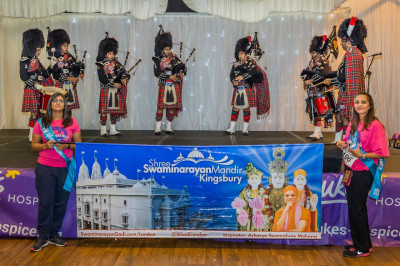 Shree Muktajeevan Pipe Band London perform at the start of the midnight walk in aid of St Luke's Hospice